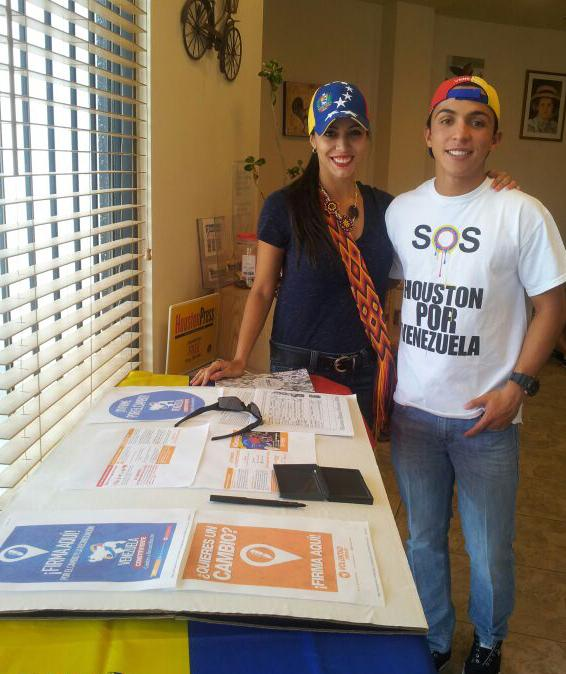 Galipoli poses with a supporter during a Voluntad Popular event.